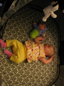 Avelynn 5 weeks napping with Glowworm